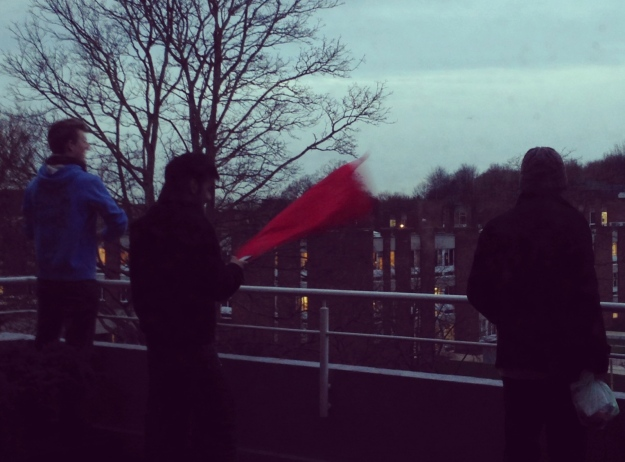 students flying a flag