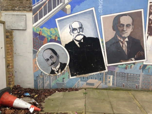 Some of the portraits at the base of the Battersea in Perspective mural.